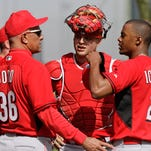 Former Reds pitcher Mario Soto, special assistant to the general manager, and catcher Devin Mesoraco talk with right-handed pitcher Raisel Iglesias during spring training in Goodyear in February.