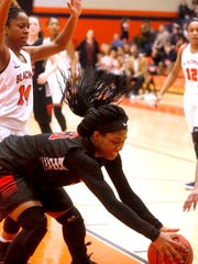 Stewarts Creek's Jamya Rogers (21) grabs the ball as