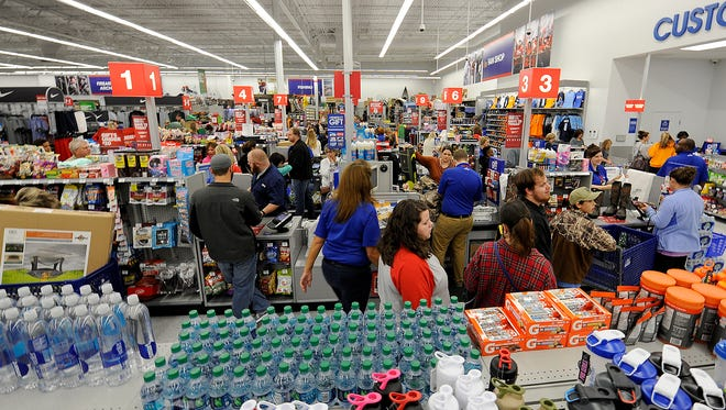 Customers check out on Black Friday at Academy Sports + Outdoors in Jackson, Tenn., on Nov. 25, 2016.