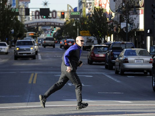 Man running across Virginia Street