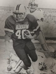 Tim Connors carries the ball for yardage during Glasgow's