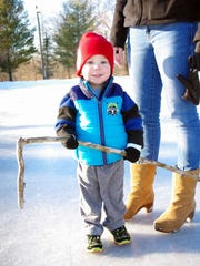 Jude McLoud, 2, from Farmington tried the ice at Ellison Park with his stick.