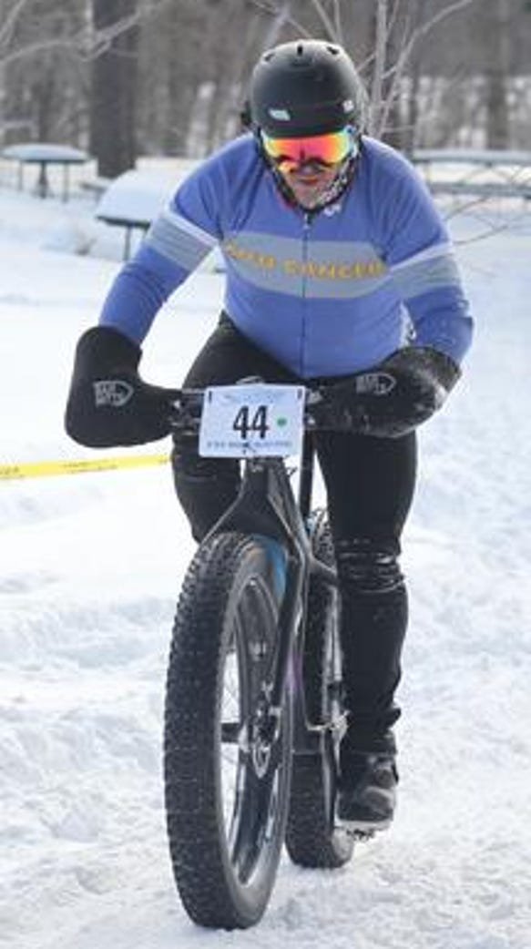 Mike Bobelak of St. Louis, Missouri, finishes his 14