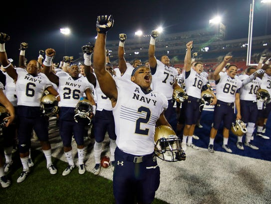 Navy running back Toneo Gulley (2) leads the cheer