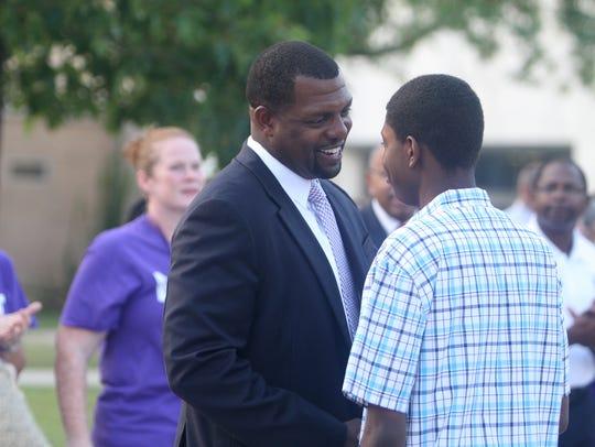Shaun Nelms, East High's superintendent, greets a student