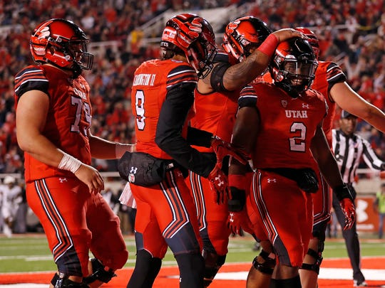 Utah (vs. Colorado, Nov. 25):  Utes running back Zack Moss (2) is congratulated after his touchdown against Colorado at Rice-Eccles Stadium. Utah won, 34-13.