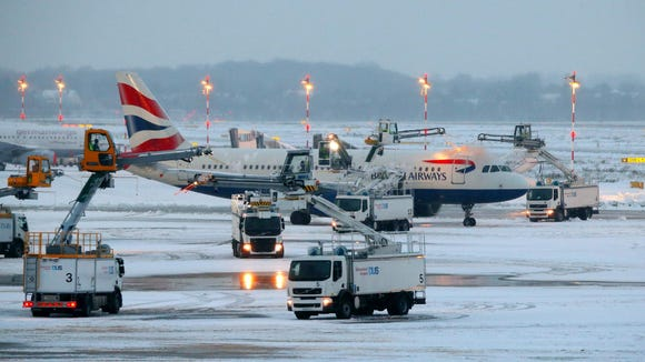 A British Airways jet is being de-iced at the airport in Dusseldorf, Germany, on Dec. 10, 2017. Due to the weather conditions, Duesseldorf airport was forced to close for four hours during the afternoon, news agency DPA reported.