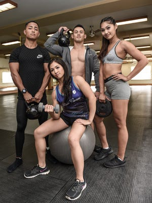 From left, Jake Limtiaco, Shalane Chaco, Joel Atenta, and Vinesha Taijeron, display their fit physiques at the International Sports Center in Anigua on March 14.