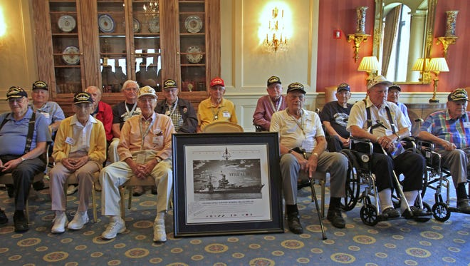 14 of the living survivors of the USS Indianapolis pose for a photo at the Columbia Club, after a luncheon which was part of the events for the USS Indianapolis survivors' 2013 reunion weekend.