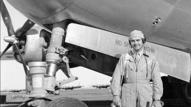 Col. Paul W. Tibbets, 31, stands beside the B-29 superfortress Enola Gay in 1945 in an unknown location. He piloted the flight which dropped the atomic bomb on Hiroshima on Aug. 6, 1945 during World War II. The plane was named after Tibbets' mother.
