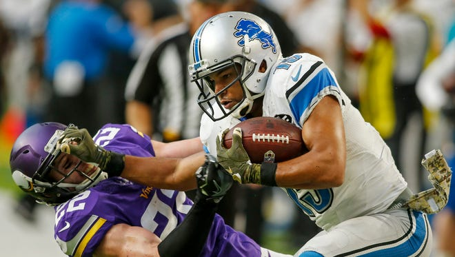 Nov 6, 2016; Minneapolis, MN, USA; Lions receiver Golden Tate shoves Vikings safety Harrison Smith to the ground and scores a touchdown to win the game in overtime at U.S. Bank Stadium.