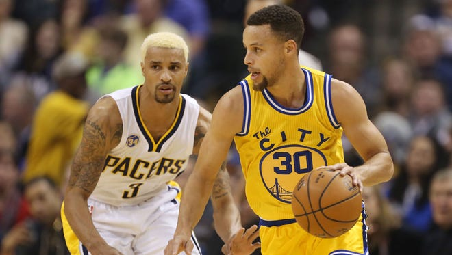 Steph Curry handles the ball against Pacers guard George Hill at Bankers Life Fieldhouse.