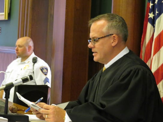 Chenango County Court Judge Frank Revoir reads the