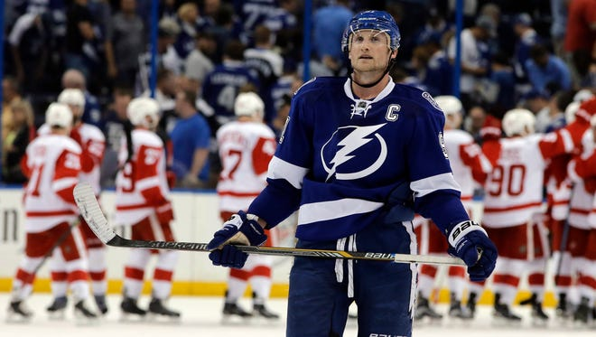 Tampa Bay Lightning center Steven Stamkos skates off as the Detroit Red Wings celebrate their 3-2 win in Game 1 on Thursday, April 16, 2015, in Tampa, Fla.