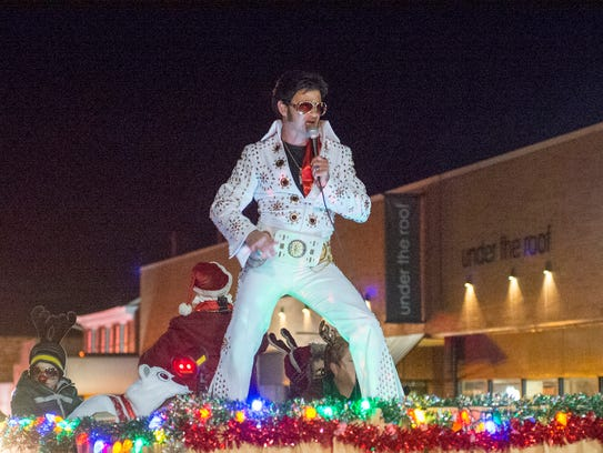 An Elvis sings for the crowds that lined the streets