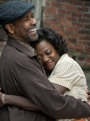 "Oscar nominees Denzel Washington and Viola Davis play Troy and Rose Maxson in ""Fences."""