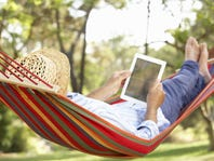 Man on hammock with tablet
