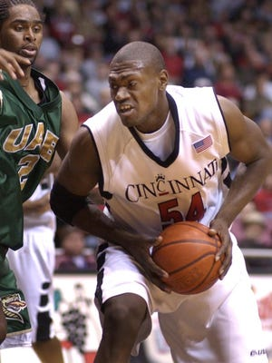 UC's Jason Maxiell looks for a shot as Gabe Kennedy of UAB pressures him UC battled UAB Wednesday, March 5, 2003..