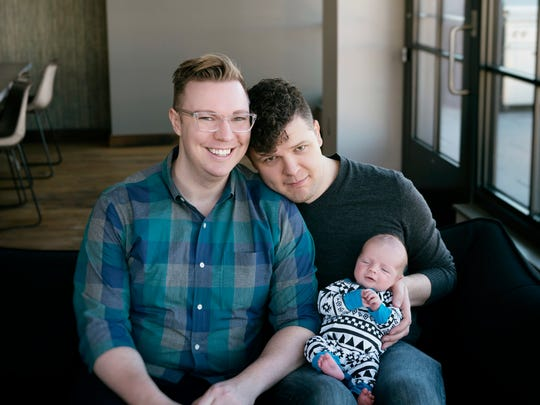 Will and Dan Neville-Rehbehn with their son, Jackson.