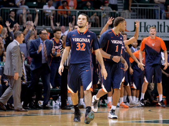 Cavaliers guard London Perrantes reacts and the Virginia