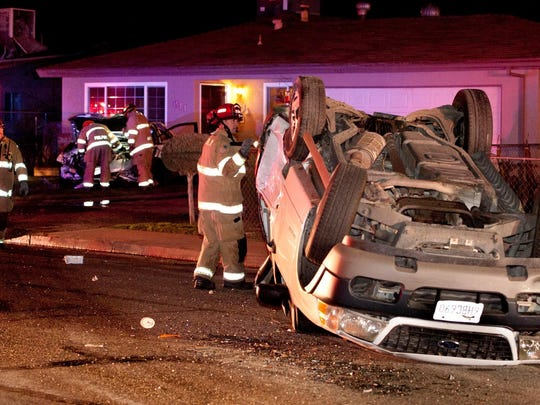Visalia Fire and Police Departments investigate a collision on Sweet Avenue at Conyer Street on Saturday, February 27, 2016. The investigation showed that a 2002 Ford Explorer, right, being driven by Luis Rocha-Lopez, was traveling eastbound on Sweet, ran a stop sign and was struck by a 1996 Acura sedan, which was being driven by a male juvenile.The 2002 Ford Explorer then collided with a 2013 Toyota Camry parked on Sweet, then rolled over and struck a male juvenile pedestrian crossing the street. Rocha-Lopez was ejected from the Ford Explorer in the rollover and his male passenger, Miguel Alcaraz, 19, was also injured.The force of the collision pushed the parked Camry into a residence in the 800 block of West Sweet Street. The residence sustained minor to moderate damage.