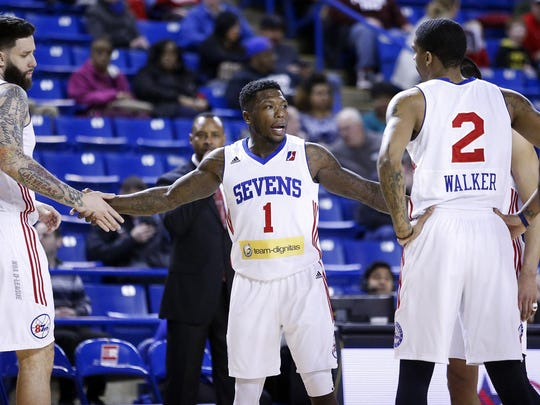 NBA veteran Nate Robinson (center) gathers his teammates against the Red Claws as he tries to prove himself as NBA-worthy during a Delaware 87ers game at the Bob Carpenter Center Tuesday.