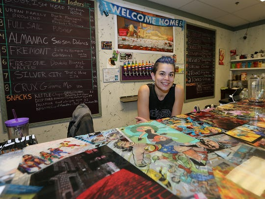Ashley Martinez hangs out in the Bremerton pub she opened in May.