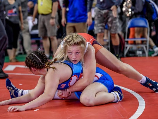 Stewartstown's Tiffani Baublitz, top, seen here in a file photo, won a state girls' wrestling title at 147 pounds on Sunday. SUBMITTED