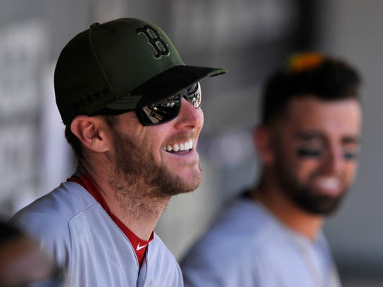 Boston Red Sox pitcher Chris Sale jokes with teammates in the dugout before a baseball game against the Chicago White Sox, Monday, May 29, 2017, in Chicago. Sale received a warm welcome in his return to Chicago on Monday following his trade to Boston last winter. (AP Photo/Paul Beaty)