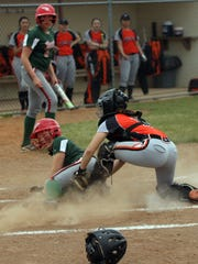 Oak Harbor's Olivia Rahm is tagged out at the plate by Gibsonburg's Jessica Davies on a play in the second inning.