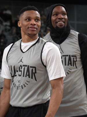 Oklahoma City Thunder guard Russell Westbrook and Golden State Warriors forward Kevin Durant react during Team LeBron practice at the Los Angeles Convention Center.