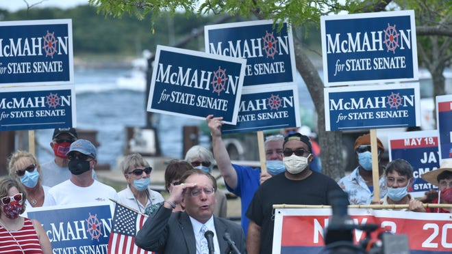"Republican James ""Jay"" McMahon III announces his candidacy for state Senate during an event Tuesday at the eastern end of the Cape Cod Canal by the Sandwich Boat Basin. McMahon questioned the government's pandemic response and whether there was a need for police reform measures in Massachusetts."