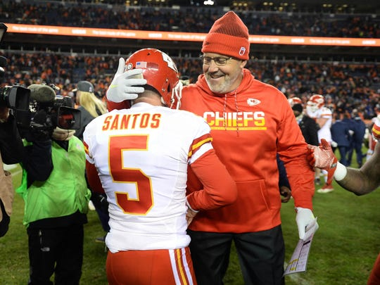 Nov 27, 2016; Denver, CO, USA; Kansas City Chiefs kicker Cairo Santos (5) and special teams coach Dave Toub celebrate the win over the Denver Broncos at Mile High. The Chiefs defeated the Broncos 30-27 in overtime. Mandatory Credit: Ron Chenoy-USA TODAY Sports