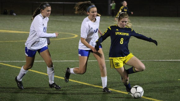 Spencerport's Leah Wengender controls the ball, with Pearl River's Aileen McBride (middle) in pursuit, during a Class A state semifinal game at Tompkins Cortland Community College in Dryden on Saturday, Nov. 12th, 2016.