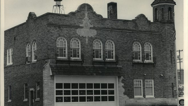 """Menomonee Falls is in negotiations to sell the former fire station, N88 W16631 Appleton Ave., in the downtown area. The station was replaced with a new fire station at the corner of Main Street and Menomonee Avenue.    """"City Hall"""" is carved in stone on the Village of Menomonee Falls fire station in 2015."""