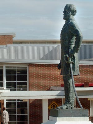 The Robert E. Lee statue stands in front of Lee High School. ADVERTISER File Robert E. Lee statue at Lee High School Thursday, Jan. 11, 2007. (Montgomery Advertiser, Julie Bennett)