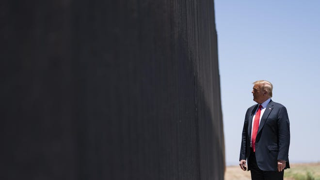 In this June 23, 2020, file photo, President Donald Trump tours a section of the border wall in San Luis, Ariz. A federal appeals court has ruled against the Trump administration in its transfer of military money to build sections of the U.S. border wall with Mexico.