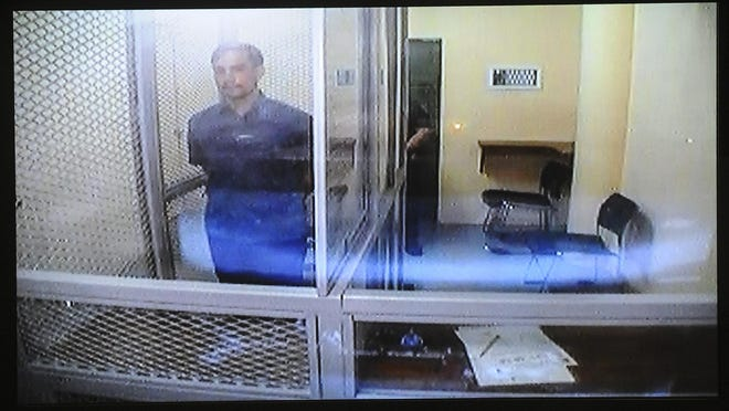 Former senatorial candidate Derick Evan Hills appears, via closed circuit video, before Magistrate Judge Alberto Tolentino at the Judiciary of Guam Northern Court Satellite in Dededo on Wednesday, Aug. 26. Hills and co-defendant, Sarah Mae Uche, face charges in relations to an alleged fraudulent medication prescription.