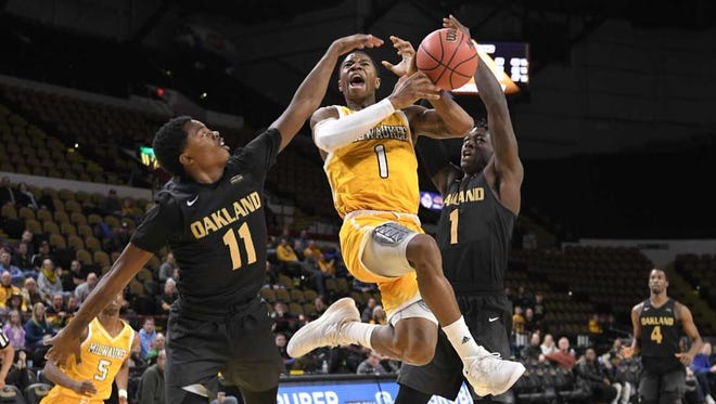 UWM guard Jeremiah Bell has the ball slapped away by Oakland defenders in the Panthers' loss on Thursday.
