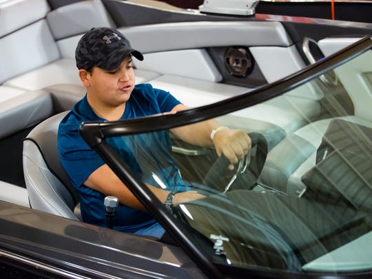 Noah Mendoza, 12, of El Paso, Texas, pretends to drive