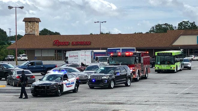 Varied vehicles gather at Garden City's Westside Shopping Center to participate in Saturday's procession against gun violence.