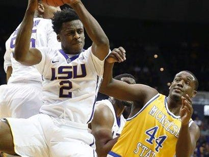 LSU guard Antonio Blakeney (2) pulls down a rebound in front of McNeese State forward Austin Lewis (44) in the second half of Friday's game.