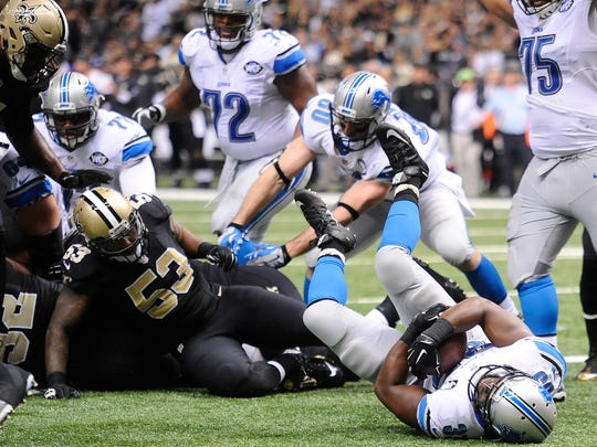 Lions running back Joique Bell goes into the end zone for a 1-yard touchdown in the fourth quarter.