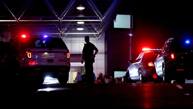 An officer directs traffic at the entrance to New Orleans International Airport on March 20 in Kenner, La.