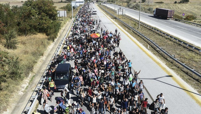 Syrian refugees marched along a highway towards the Turkish-Greek border in late September. Many have fled the civil war that keeps raging at home.