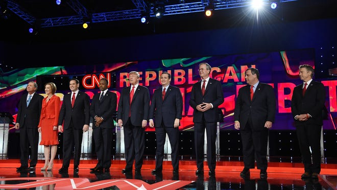 Republican presidential candidates (from left) Ohio Gov. John Kasich, Carly Fiorina, Sen. Marco Rubio, Ben Carson, Donald Trump, Sen. Ted Cruz, Jeb Bush, New Jersey Gov. Chris Christie and Sen. Rand Paul are introduced during the CNN presidential debate at the Venetian Las Vegas on Tuesday.