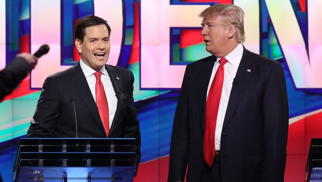 Florida Sen. Marco Rubio, left, and businessman Donald Trump chat during a break at a presidential candidates debate in March at the University of Miami.