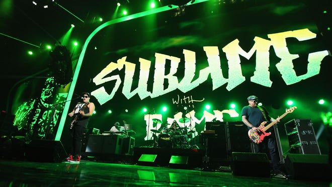 Singer/guitarist Rome Ramirez, Bud Gaugh, and Eric Wilson of the band Sublime With Rome performs onstage at the iHeartRadio Music Festival. The band is set to perform at the Pavilion on November 2.