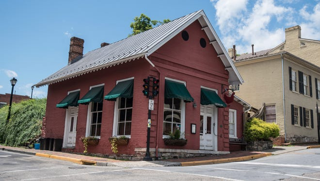 "This Saturday, June 23, 2018 photo shows the Red Hen Restaurant in downtown Lexington, Va. White House press secretary Sarah Huckabee Sanders said Saturday in a tweet that she was booted from the Virginia restaurant because she works for President Donald Trump. Sanders said she was told by the owner of The Red Hen  that she had to ""leave because I work for @POTUS and I politely left.""  (AP Photo/Daniel Lin)"
