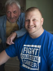 Colon cancer survivor Ed Yakacki III, 36, sits with his father, Ed  Jr. The younger Yakacki, who survived  cancer, will be featured on a 2016 calendar to promote awareness about the disease.